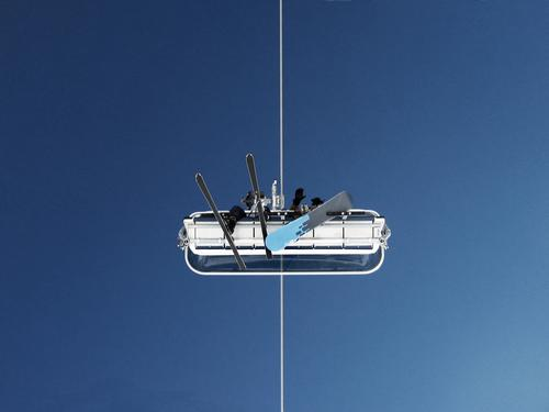 Sky Winter Above Sit In pairs Tall Logistics Cable Skiing Middle Cloudless sky Upward Symmetry Blue sky Skier Snowboard