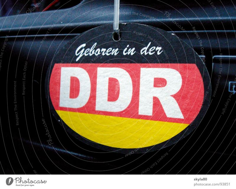 Car Characters Signage Stripe Cardboard GDR Pride Politics and state East GDR flag Reunification Integration Attach Patriotism Coat of arms Signs and labeling