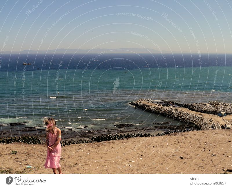 Water Ocean Summer Beach Loneliness Far-off places Wall (barrier) Sand Small Pink Wind Horizon Gloomy Dress Stripe Footbridge