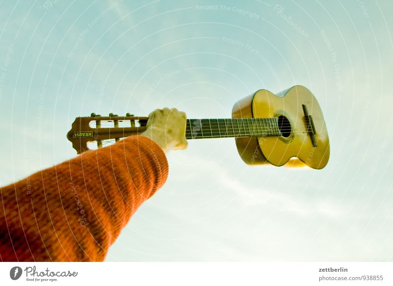 FRIZZ Guitar Music Musical instrument Plucked instrument Folklore Folklore music Song book Hand Arm To hold on Lift Sky Worm's-eye view Joy