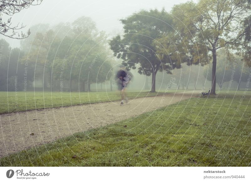 Jogging in morning fog Lifestyle Body Healthy Athletic Fitness Winter Sports Human being Park fit Sports Training Frankfurt Adults Morning Fog chill Action Cold