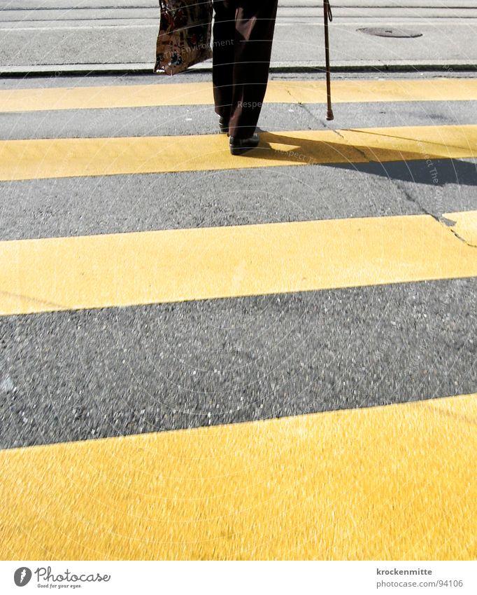 Woman City Senior citizen Yellow Street Footwear Going Transport Asphalt Stripe Stick Pedestrian Tar Street sign Intersection Traverse