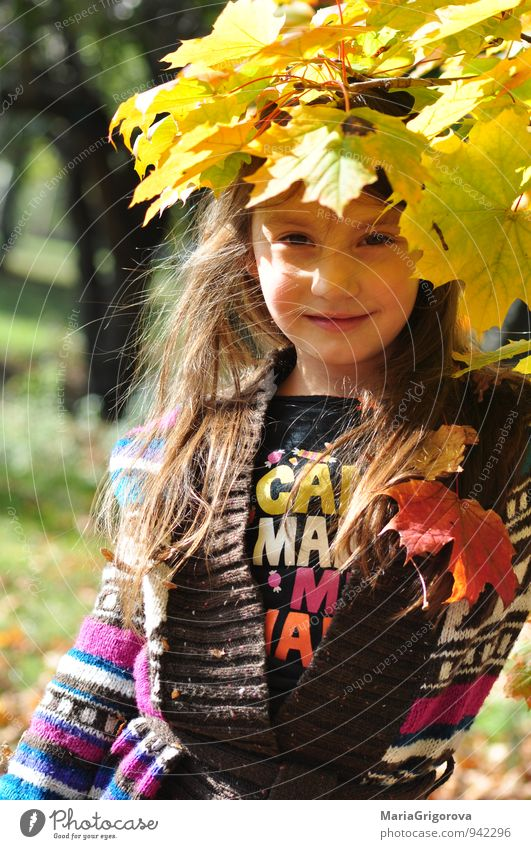 Beautiful girl enjoying autumn leaves in park Human being Child Nature Blue Green Tree Red Girl Yellow Face Autumn Emotions Hair and hairstyles Healthy Garden
