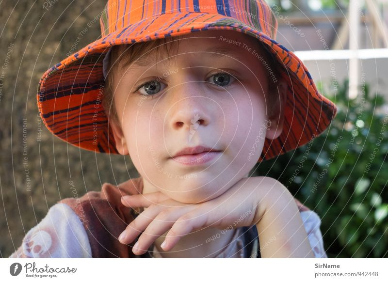 286 [a quiet day] Contentment Vacation & Travel Summer Child Boy (child) Infancy Life 1 Human being 3 - 8 years Beautiful weather Tree Bushes Garden Hat Cap