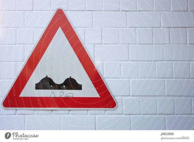 tit Road sign Wall (building) Transport Daub Emotion design Signs and labeling Wall (barrier) Elevation Clue Signage Warning sign Warning label Joke Funny