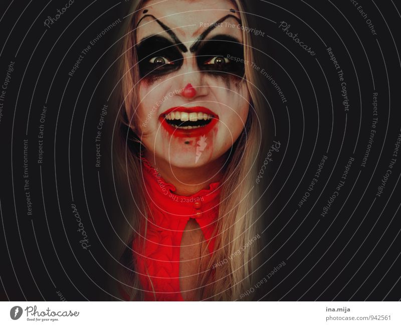 creepy young laughing woman made up as horror clown Feasts & Celebrations Carnival Hallowe'en Human being Feminine Face 1 Anger Red Black Emotions Moody