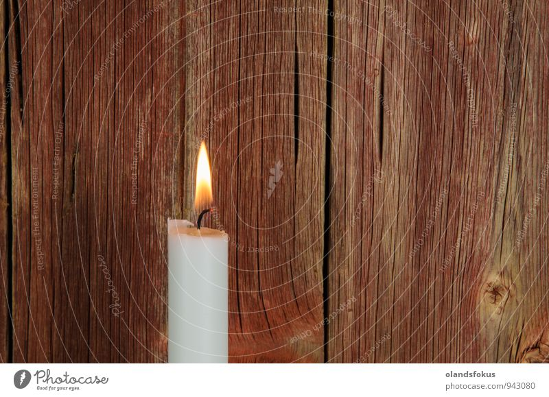 Single burning candle at red weathered background Interior design Decoration Candle Old Retro Red White Nostalgia Antique burial candlelight christmas mourning