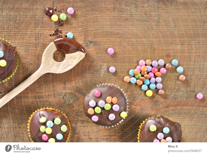 chocolate party Food Dough Baked goods Dessert Candy Chocolate Nutrition To have a coffee Spoon Delicious Sweet Chocolate buttons Muffin Birthday cake