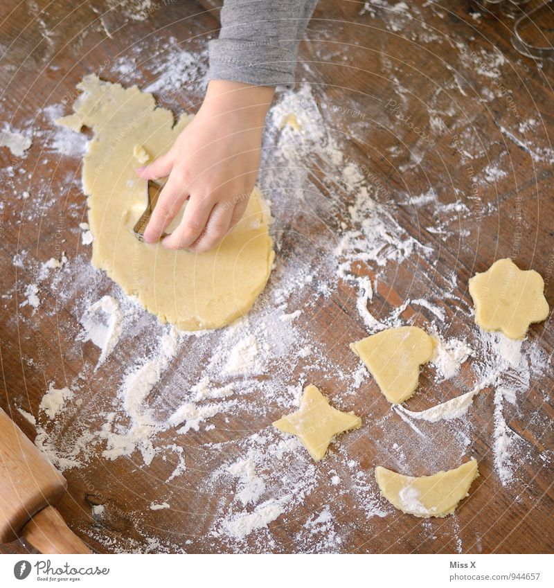 dough Food Dough Baked goods Nutrition Christmas & Advent Child Hand Wood Delicious Sweet Cookie Christmas biscuit Baking tin cookie cutter cookie dough Flour