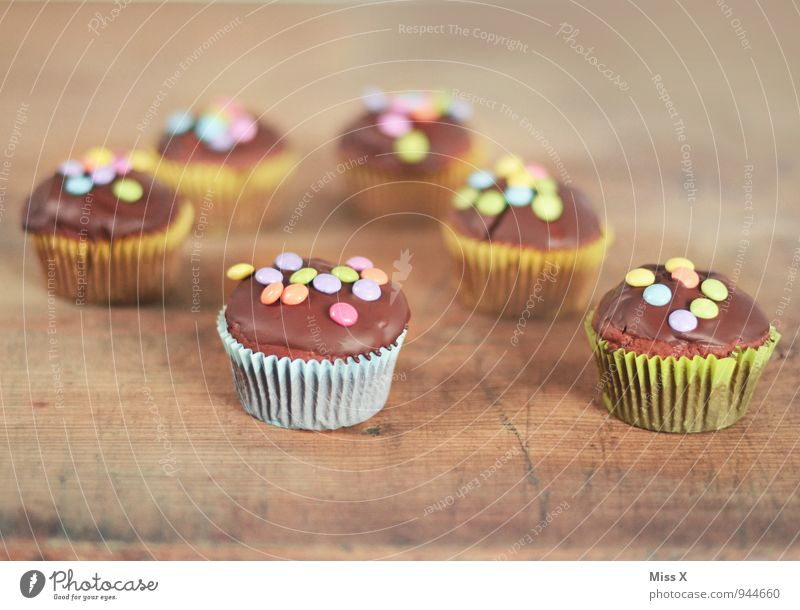 Feasts & Celebrations Food Birthday Nutrition Sweet Cooking & Baking Delicious Candy Cake Baked goods Chocolate Dough Dessert Wooden table Muffin Birthday cake