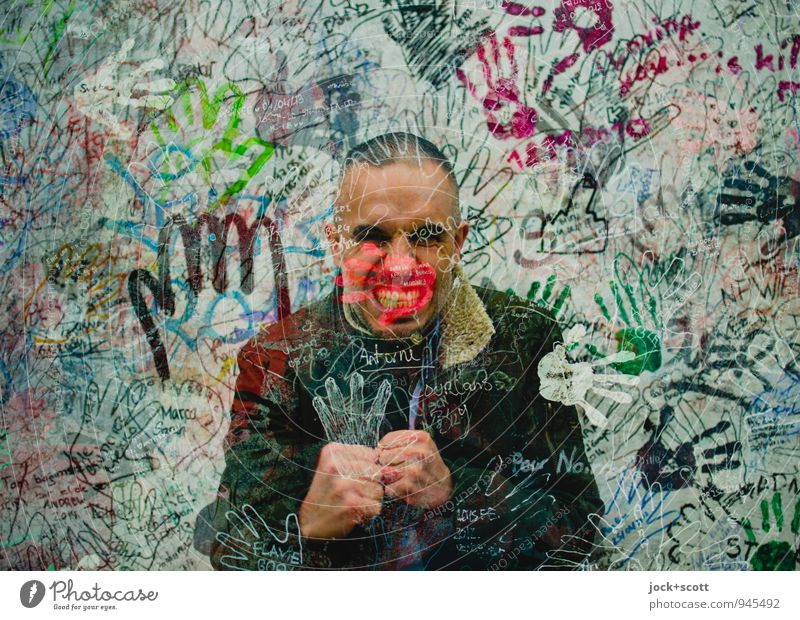 push through Boxing Man Adults Hand Crowd of people 30 - 45 years Street art The Wall Jacket Short-haired Contour Fight Cool (slang) Uniqueness Nerdy Strong
