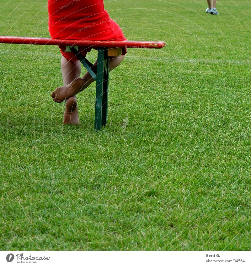 Human being Green Red Meadow Sports Playing Grass Feet Grass surface Audience Seating Sneakers Barefoot Sporting grounds Wooden bench