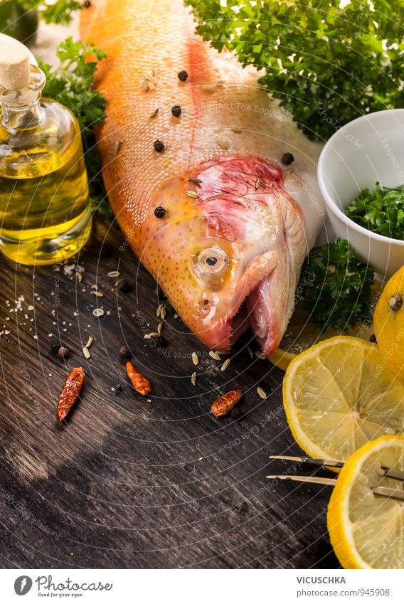Whole rainbow trout, spices, lemon and oil. Food Fish Vegetable Fruit Herbs and spices Cooking oil Nutrition Lunch Dinner Organic produce Vegetarian diet Diet