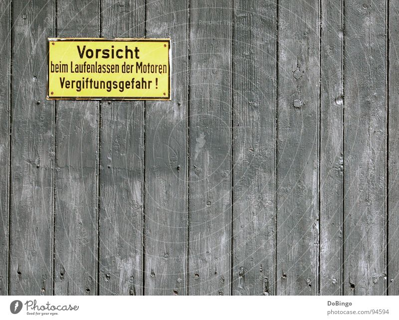 Yellow Wall (building) Wood Gray Metal Signs and labeling Dangerous Threat Derelict Rust Wooden board Respect Engines Warning label Caution Attentive