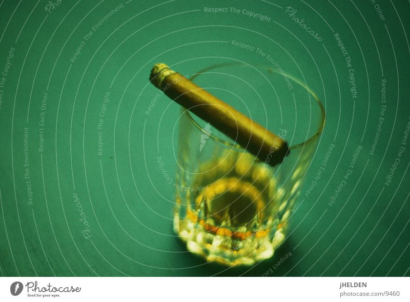 whiskey & cigars Food Beverage Alcoholic drinks Spirits Glass Style Calm Smoke Elegant Delicious Reliability Strong Brown Gold Green Emotions Moody Vice Power