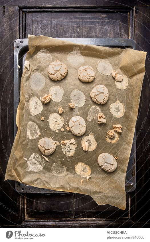 Cookies with cracks on baking paper and old baking tray. Food Dough Baked goods Dessert Nutrition To have a coffee Organic produce Vegetarian diet Diet