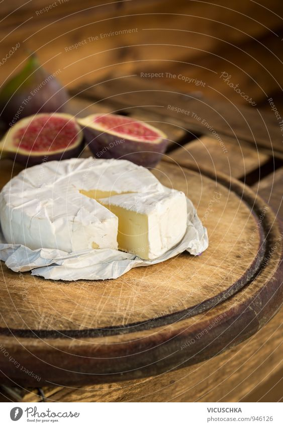 Camembert on old wooden board Food Cheese Fruit Dessert Nutrition Eating Breakfast Organic produce Vegetarian diet Healthy Eating Soft Brown Yellow White
