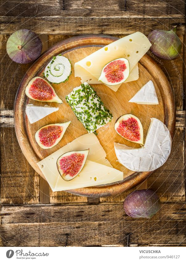 Round cutting board with cheese and figs Food Cheese Fruit Nutrition Breakfast Lunch Buffet Brunch Banquet Picnic Organic produce Vegetarian diet Diet Lifestyle