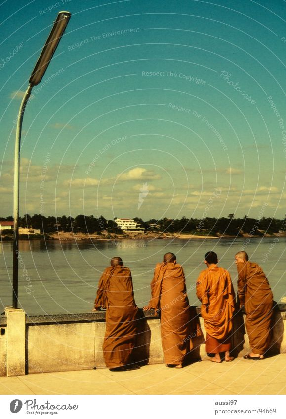 monk's whisper Monk Religion and faith Buddhism Thailand Asia Laos Myanmar Power Force Buddha Orange Mekong