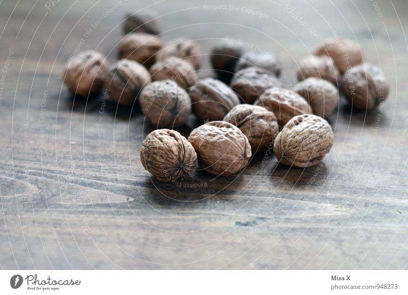 nuts Food Nutrition Organic produce Vegetarian diet Healthy Eating Delicious Walnut Nutshell Hard Kernels & Pits & Stones Sheath Wood Colour photo