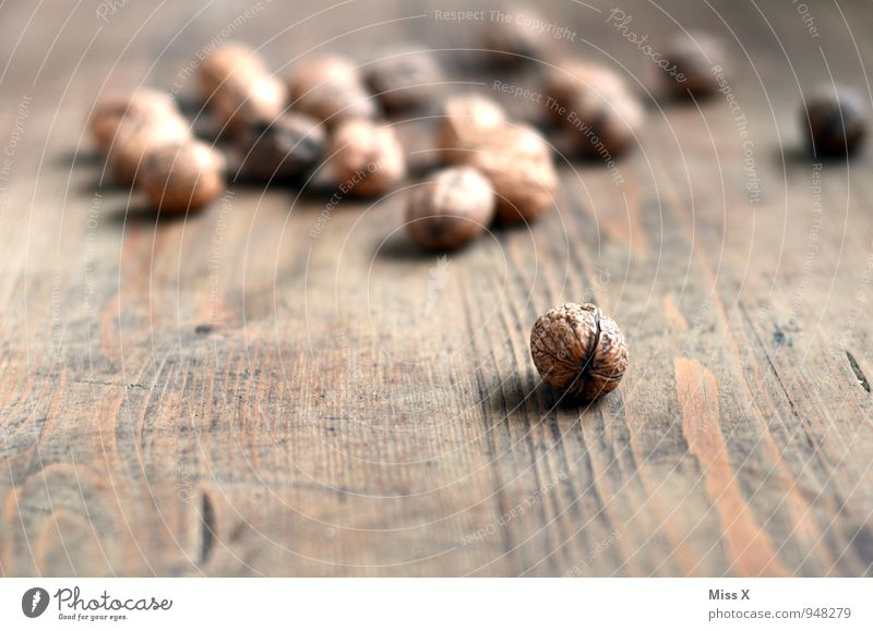nuts Food Nutrition Organic produce Vegetarian diet Table Wood Brown Walnut Nutshell Hard Ingredients Wooden table Colour photo Subdued colour Close-up