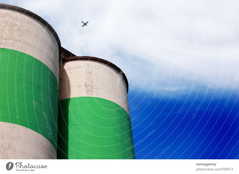 Thick things Green White Clouds Multicoloured Gaudy Silo Stripe Round Airplane Large Might Far-off places Small Crash Industry Blue Sky Contrast Tower Fear