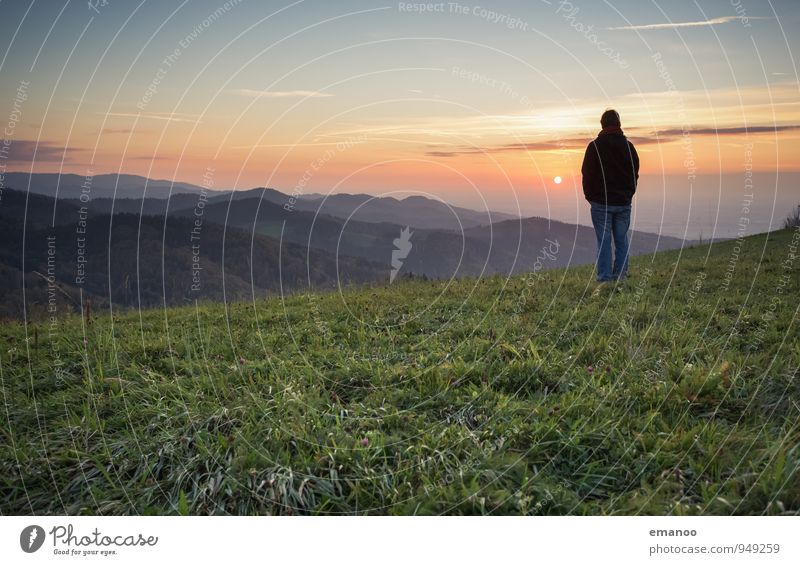Man on mountains in the Black Forest at sunset over the Upper Rhine Rift Lifestyle Joy Well-being Contentment Relaxation Calm Vacation & Travel Tourism