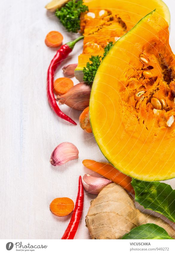 Quarter of pumpkin with seeds and ingredients for soup Food Vegetable Soup Stew Herbs and spices Nutrition Life Summer Thanksgiving Hallowe'en Yellow Design