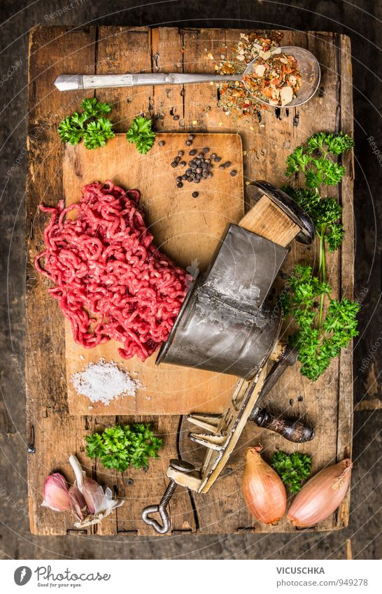 Minced meat in vintage mincer with herbs and spices. Food Meat Vegetable Herbs and spices Nutrition Lunch Dinner Organic produce Diet Lifestyle Healthy Eating