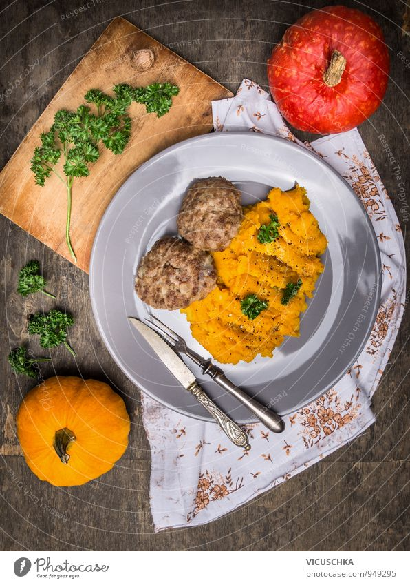 Pumpkin puree with meat meatballs. Food Meat Vegetable Nutrition Lunch Dinner Banquet Organic produce Diet Crockery Plate Cutlery Knives Fork Healthy Eating