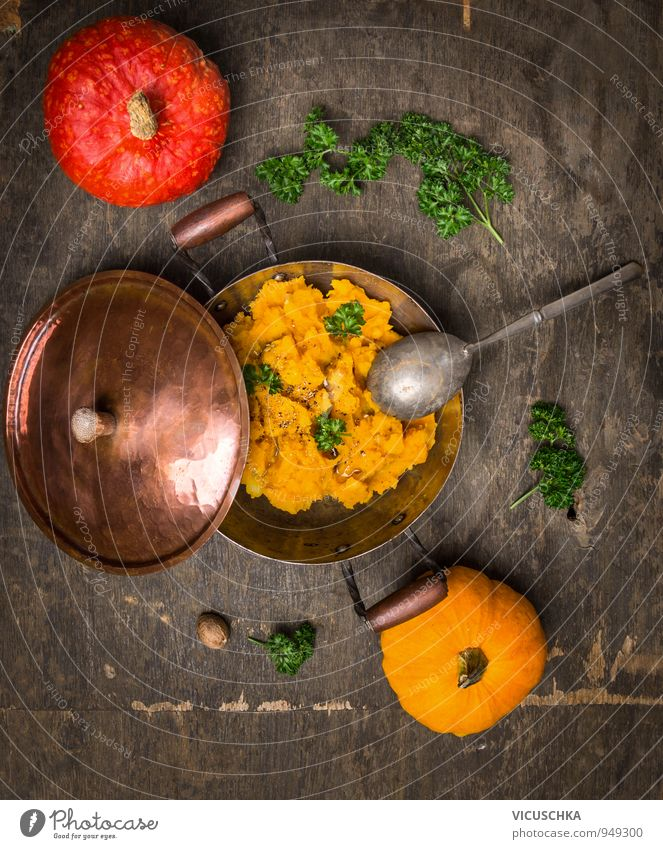 pumpkin puree in old pot with red and yellow pumpkin Food Vegetable Soup Stew Herbs and spices Nutrition Lunch Organic produce Vegetarian diet Diet Pot Spoon