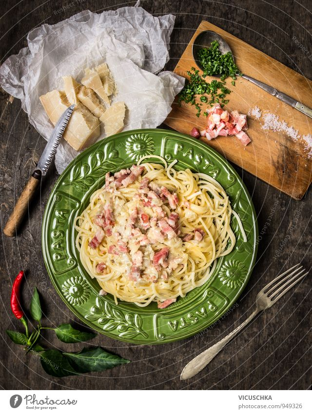 Pasta Carbonara and ingredients. Food Sausage Cheese Vegetable Herbs and spices Nutrition Lunch Dinner Banquet Organic produce Diet Italian Food Plate Knives