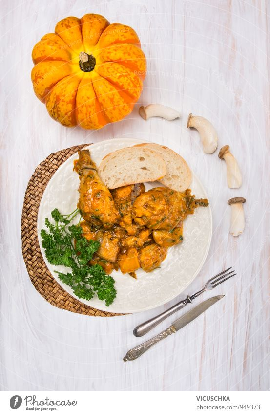 Chicken thigh with pumpkin and mushroom sauce Food Vegetable Soup Stew Herbs and spices Nutrition Lunch Banquet Organic produce Diet Crockery Plate Cutlery