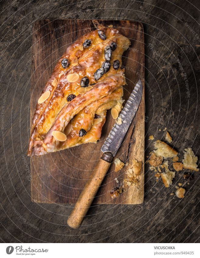 Coffee cake on old cutting board with knife Food Dough Baked goods Cake Nutrition To have a coffee Crockery Knives Style Design Kitchen coffee cake Almond