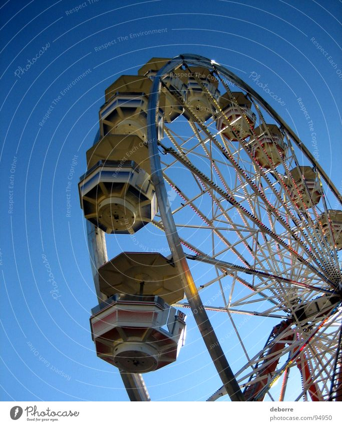 Under the wheel Yellow Ferris wheel Large Fairs & Carnivals Carousel Round Things Blue Joy Tall Circle