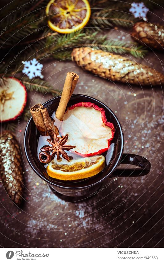 Mulled wine with dried fruits on winter decoration Food Fruit Apple Orange Herbs and spices Banquet Beverage Hot drink Tea Alcoholic drinks Wine Cup Lifestyle