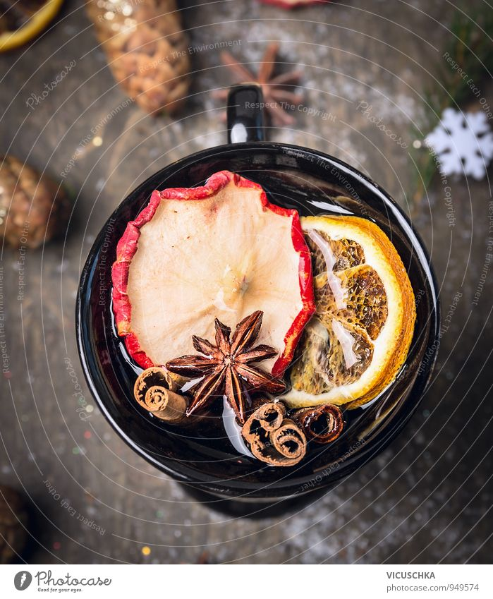 Cup of mulled wine on dark wood with snow. Food Fruit Herbs and spices Beverage Hot drink Tea Alcoholic drinks Wine Mulled wine Design Winter Christmas & Advent