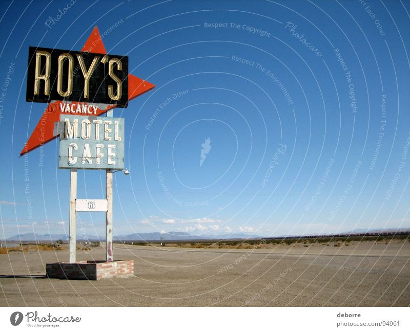 Retro American highway sign for Roy's Motel on Route 66. Hotel Accommodation Americas Café Street sign Room USA Living or residing Signs and labeling Blue Sky
