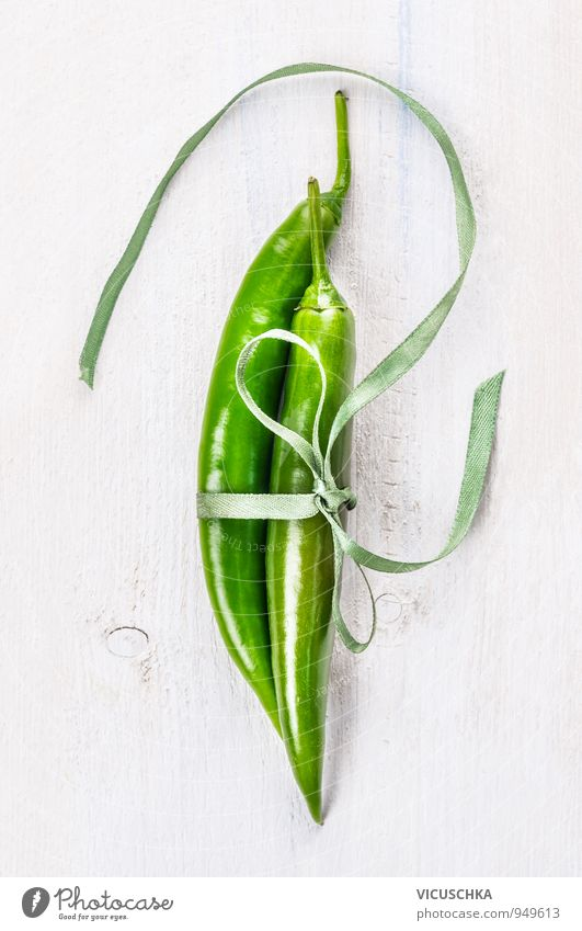 Two green chili peppers bound with ribbon Food Vegetable Herbs and spices Lifestyle Style Design Leisure and hobbies Nature Chili Background picture Tangy Fresh