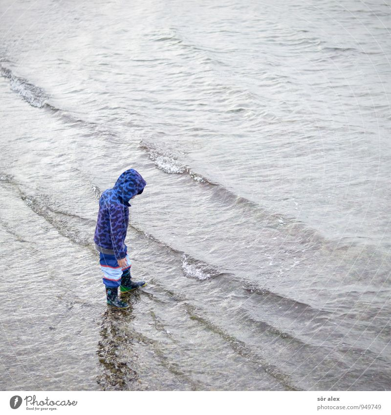 splash Human being Child Toddler Infancy 1 3 - 8 years Environment Water Autumn Climate Bad weather Wind Baltic Sea Ocean Clothing Rain jacket Boots Playing Wet