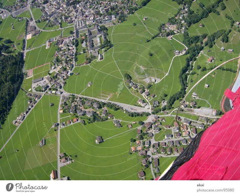 Paragliding over Engelberg Operational Paraglider Play of colours Sky blue Clearance for take-off Monitoring Warped Switzerland Joy Leisure and hobbies Aviation