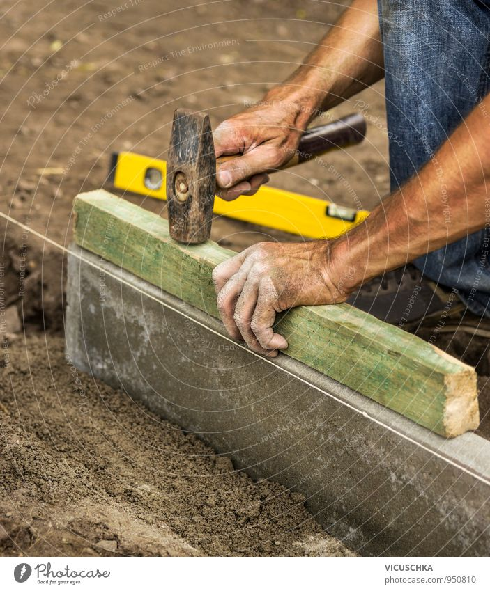 Hammer in male hands on the construction site Profession Tool Measuring instrument Human being Man Adults Hand 1 Build Construction site Knock Brick