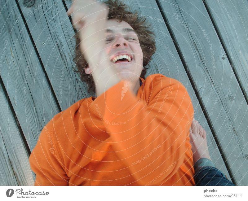 Human being Man Joy Movement Laughter Feet Lake Orange Footbridge Sweater