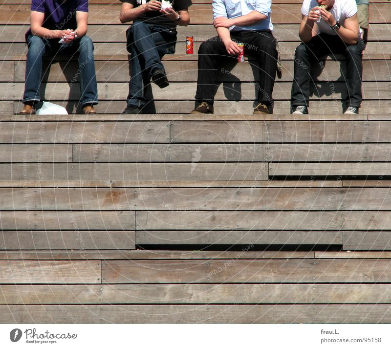 Mealtime! Lunch hour Stands Man Break Midday Wood Employees & Colleagues Friendship Human being Leisure and hobbies Stairs Jeans Nutrition