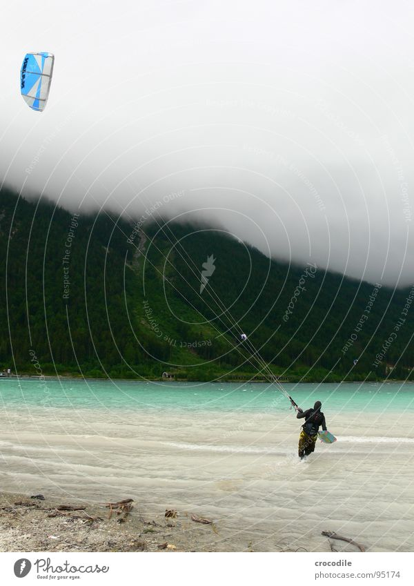 skystormer Kiter Surfer Lake Lake Achensee Federal State of Tyrol Cold Wind Clouds Passion Dark Beach String Forest Sports Dangerous Extreme sports kitesurfer