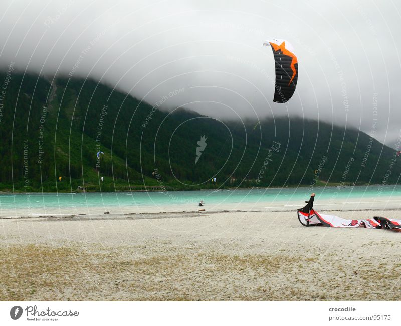 kitesurfing in austria Kiter Surfer Lake Lake Achensee Federal State of Tyrol Cold Wind Clouds Passion Dark Beach String Forest Sports Dangerous Man