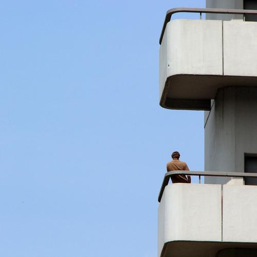 BALCONY SMOKER Sky Guard Guard service Sightseeing Stand Loneliness Break Summer Man Fellow Human being University & College student Balcony Concrete