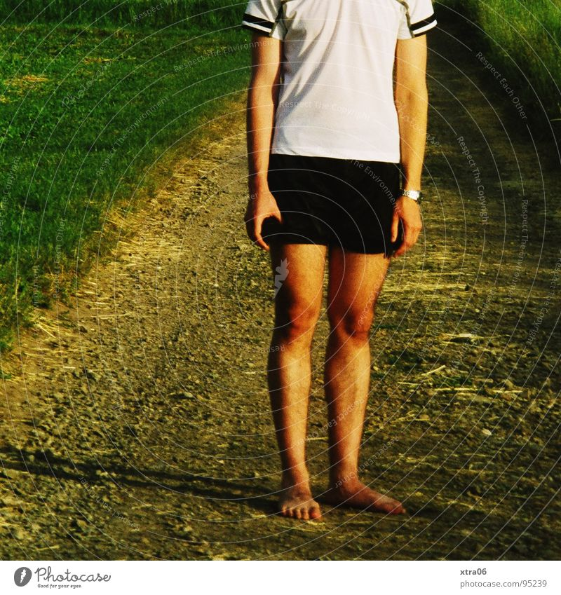 Human being Man Green Loneliness Grass Lanes & trails Legs Arm Hiking Going Lawn T-shirt Stand Fatigue Shorts Barefoot