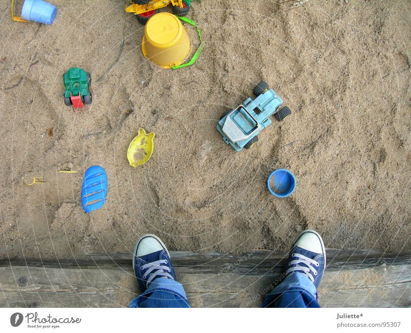 Child Playing Above Sand Stand Bottle Chucks Playground Sandpit Sneakers Sand toys