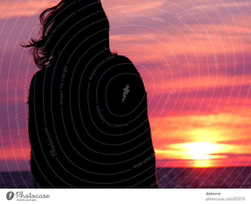 Silhouette of young woman standing on the beach with a pink sunset in the background. Romance Red Violet Sunset Ocean Clouds Woman Black Beach Summer Orange Sky